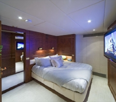 Luxurious Bedroom Setting With HDTV Screen and Audio, Video System