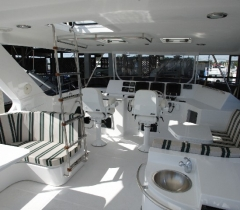 Front Section of A Yacht With Luxurious Seating Area and Digital Surround System