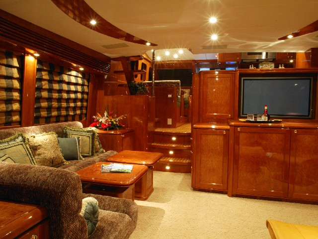 Yacht living room with controlled lighting and media