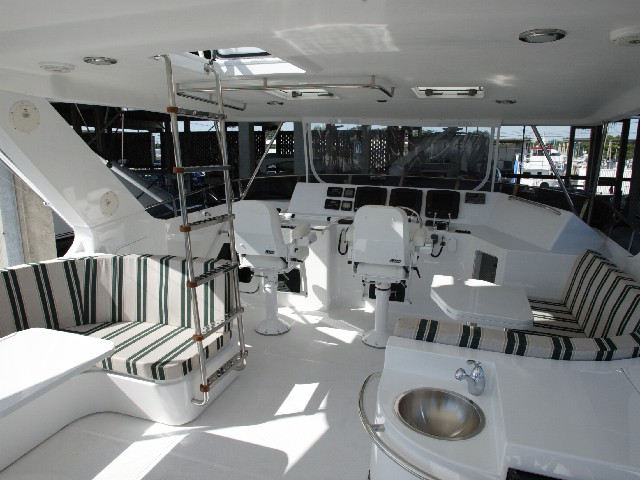 helm and upper deck seating area with surround sound